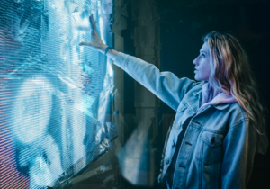 Woman reaching out to futuristic screen